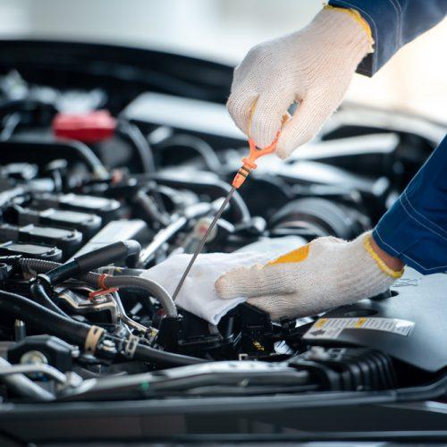 Asian,Car,Mechanic,In,An,Auto,Repair,Shop,Is,Checking